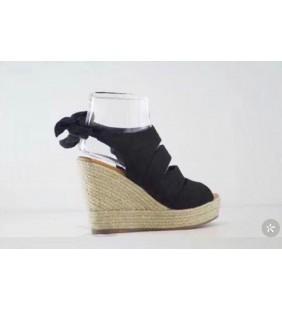 Sandal compensée